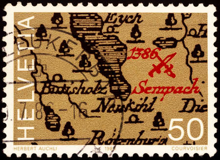 Moscow, Russia - February 20, 2021: stamp printed in Switzerland shows Map with location of the battle (1386), dedicated to the 600th Anniversary of Sempach Battle, circa 1986 Editorial