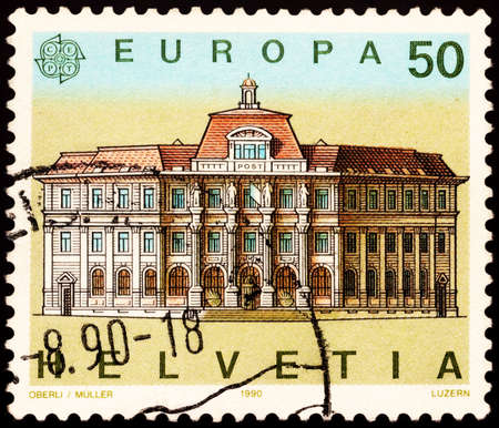 Moscow, Russia - February 20, 2021: stamp printed in Switzerland shows Main post office in Luzern, Switzerland, series Europa (CEPT) - Post Offices, circa 1990