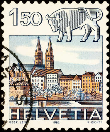 Moscow, Russia - February 21, 2021: stamp printed in Switzerland shows Image of Taurus - sign of zodiac and Basel Cathedral, series Zodiac signs and landscapes, circa 1982