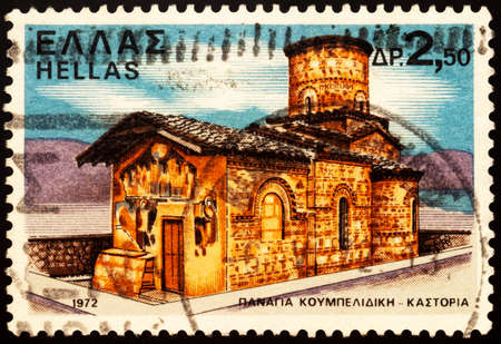 Moscow, Russia - February 26, 2021: stamp printed in Greece shows Church of Panagia Koumbelidiki, Kastoria, West Macedonia, Greece, series Monasteries and Churches, circa 1972