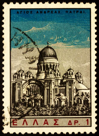 Moscow, Russia - February 24, 2021: stamp printed in Greece shows Cathedral Church of Saint Andrew in Patras, Peloponnese, Greece, series St Andrew, circa 1965