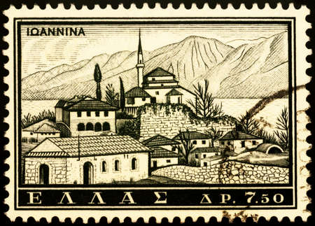 Moscow, Russia - February 24, 2021: stamp printed in Greece shows Ioannina, Epirus, Greece, series Tourism - Landscapes and Monuments, circa 1961