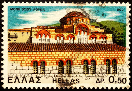 Moscow, Russia - February 25, 2021: stamp printed in Greece shows Monastery of Saint Lucas in Viotia under Acropolis, Greece, series Monasteries and Churches, circa 1972