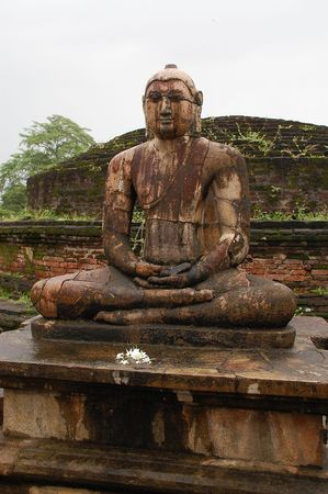 obeisance: Four seated Buddhas are located in the Vatadage ancient house of relic in Polonnaruwa, Sri Lanka. One of them is shown in the picture.