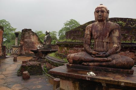 obeisance: Two statues of seated Buddha in the Vatadage ancient house of relic in the town of Polonnaruwa, Sri Lanka.  Stock Photo