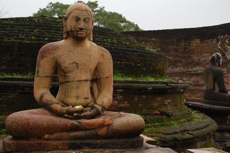 obeisance: Seated Buddha statues in the Vatadage temple in the town of Polonnaruwa, Sri Lanka.
