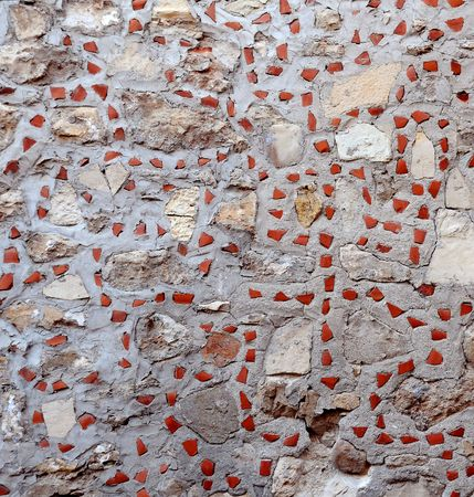 inclusions: Fragment of the light brown stone wall with inclusions