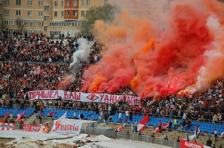"Spartak soccer team fans from Moscow are the most notorious and aggressive fans in Russia. The banner the fans are holding says: ""Your Judgment day has come"". Stock Photo - 6885535"