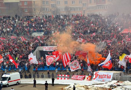 Football club SpartakMoscow fans support their team during the match vs FC DynamoMoscow at Dynamo stadium in Moscow, Russia, on the 13th of April, 2008.  Editorial