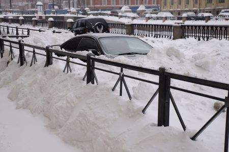 snowbank: Car in the snowbank on the street of St.Petersburg in Russia during Russian Christmas holiday in Jan, 2010 Editorial