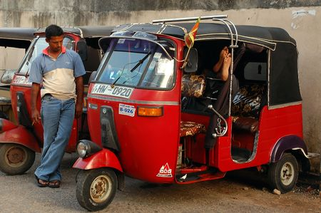 Three-wheeler drivers awaiting passengers near the shopping center in Coilombo/Sri Lanka on the 13th of December, 2008. Stock Photo - 6889257
