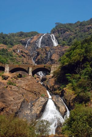 Dudhsagar waterfall and railroad bridge in GoaIndia Stock Photo