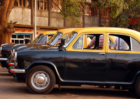 awaiting: Anbassador cabs awaiting passengers at the cab-stand in India.