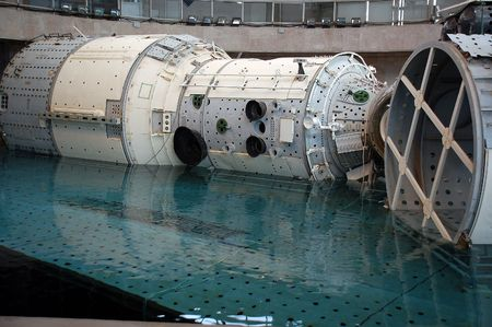 immersion: The Russian segment mockup of the International Space Station is descending on the platform at the Russian Hydrolab water immersion facility (Gagarin Cosmonaut Training Center in Star City near Moscow). Cosmonauts and astronauts train for spacewalks in th