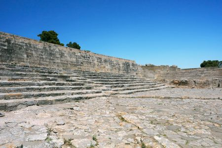 Ruins of Phaestus on Crete island, supposedly an ancient theater, against blue sky background.. Stock Photo