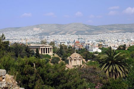 View of Orthodox church and temple of Hephaestus in Agora in Athens, Greece photo