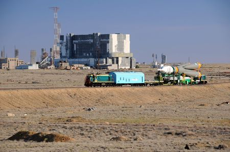 orbital spacecraft: Soyuz rocket is being rolled out to the launch pad along the railroad tracks at Baikonur, Kazakhstan, on the 13th of June, 2010