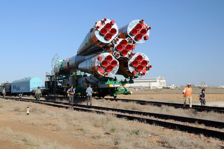 escorted: Soyuz launch vehicle escorted by the Russian security is being transported to the launch pad along the railroad tracks at Baikonur, Kazakhstan, on the 13th of June, 2010.