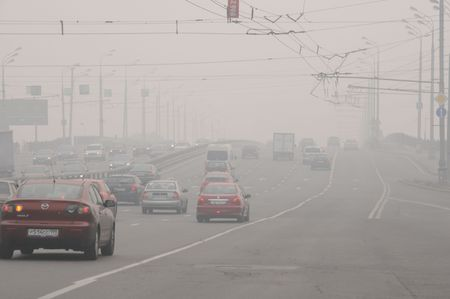 MOSCOW, RUSSIA - AUGUST 7: Cars run down Krestovsky Bridge in thick smog August 7, 2010 in Moscow, Russia.