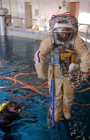 immersion: STAR CITY, RUSSIA - FEBRUARY 25: US astronaut M.Barratt is taken into water for spacewalk training at Russian Hydrolab water immersion facility Feb 25, 2009 in Star City, Russia. SCUBA diver assists