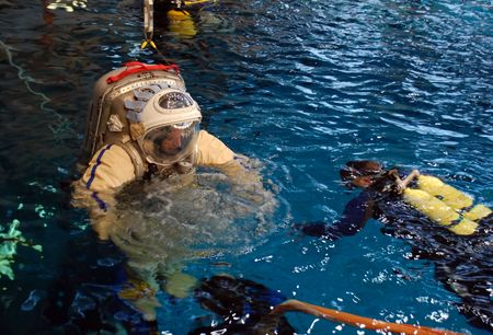 STAR CITY, RUSSIA - FEBRUARY 20: US astronaut J.Williams is taken into water for spacewalk training at Russian Hydrolab water immersion facility Feb 20, 2009 in Star City, Russia. SCUBA divers assists Редакционное