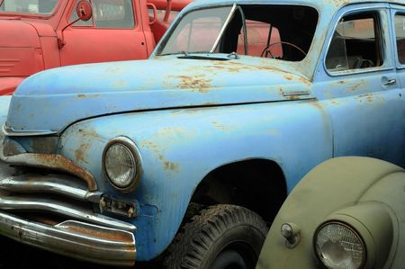 Rusty vintage cars in the graveyard in Russia photo
