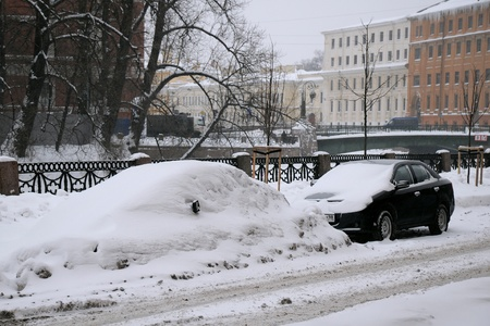 SAINT-PETERSBURG, RUSSIA - JANUARY 7: Cars under snow in St.Petersburg on the day of the Russian Christmas January 7, 2010, Russia. Stock Photo - 8607817