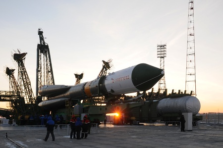 orbital spacecraft: BAIKONUR, KAZAKHSTAN - JANUARY 26: Progress cargo spacecraft is being elevated on the launch tower at sunrise January 26, 2011 at Baikonur cosmodrome, Kazakhstan.