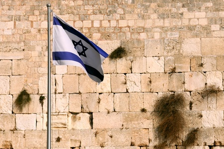 western state: State flag of Israel against the background of the Wailing wall in Jerusalem, Israel. Stock Photo