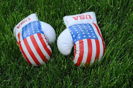 Used boxing gloves with US flag image on the lawn photo