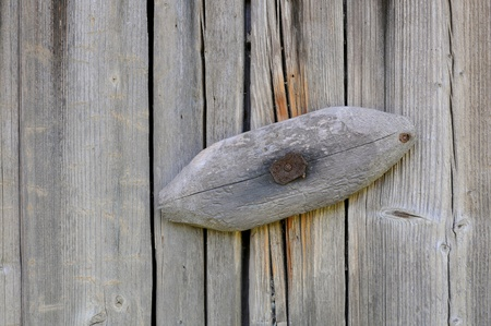Wooden gate latch on the old shabby barn photo