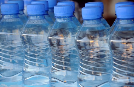 Closeup image of mineral water bottles in grocery store photo
