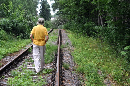 forest railroad: Caucasian lady walking down abandoned railroad track