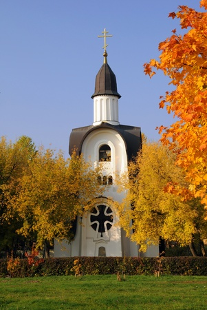 Old white chapel and golden trees in the fall in Central Russia Stock Photo - 10836132