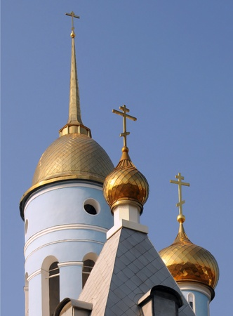 worshiper: Golden domes of the Russian Orthodox church against the blue sky background