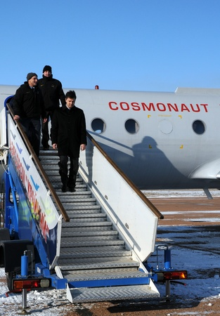 increment: BAIKONUR, KAZAKHSTAN - DECEMBER 8: Increment 30 crew (L-R: Don Petit, Andre Kuipers, Oleg Kononenko) are getting off the plane upon arrival in Baikonur December 8, 2011 Baikonur, Kazakhstan Editorial