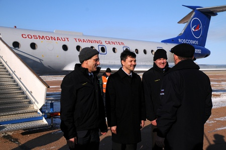 rsc: BAIKONUR, KAZAKHSTAN - DECEMBER 8: Increment 30 crew (L-R: Don Petit, Oleg Kononenko, Andre Kuipers) are greeted by Deputy Chief Designer of RSC Energia Mr.Zelenshchikov upon arrival in Baikonur December 8, 2011 Baikonur, Kazakhstan Editorial