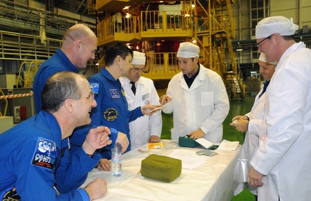 increment: BAIKONUR, KAZAKHSTAN - DECEMBER 9: Increment 30 crew (Petit, Kuipers, Kononenko,) during pre-launch training December 9, 2011, Baikonur Cosmodrome, Kazakhstan. Soyuz spacecraft will fly to ISS on the 21st of December, 2011