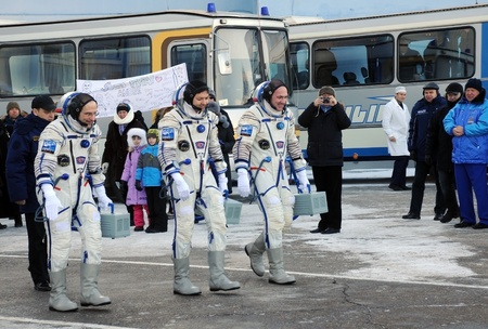 orbital spacecraft: BAIKONUR, KAZAKHSTAN � DECEMBER 21: Expedition 31 crew (D.Pettit, O.Kononenko, A.Kuipers) walk out to report that they are ready for the flight to ISS Dec 21, 2011at Baikonur cosmodrome, Kazakhstan