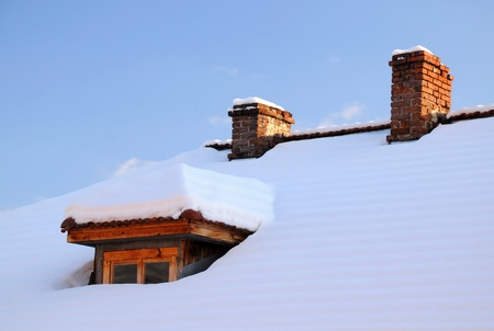 attic window: Wooden attic window and two chimnies in the winter Stock Photo