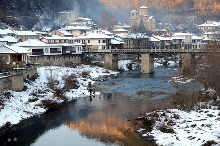 The Yantra river and Asenov district of Veliko Tarnovo in Bulgaria in the winter photo