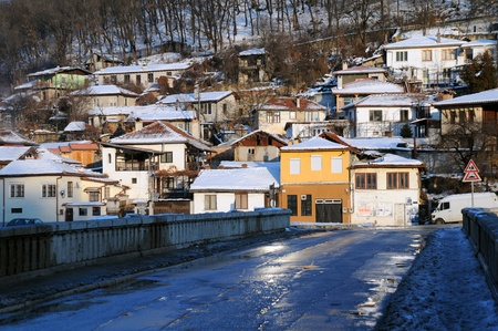 overpopulation: Bridge and houses of Asenov district in the city of Veliko Tarnovo in Bulgaria Stock Photo