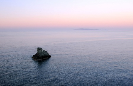 Two small islands near the coast of Crete island in Greece at sunset Stock Photo - 12221142