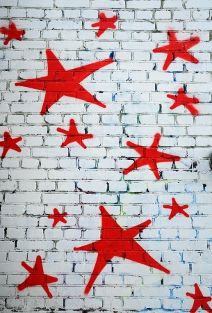 grafitti: Red stars on the white brick wall Editorial