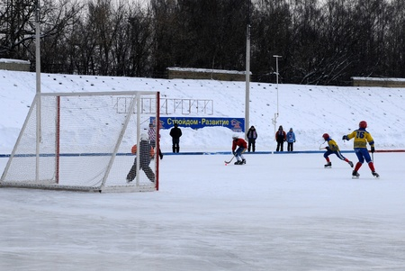 KOROLEV, RUSSIA � FEBRUARY 4: Vympel Korolev bandy junior team (red jersey) vs RusichLikino-Dulevo junior team in brutally cold weather February 4, 2012, in Korolev, Moscow region, Russia