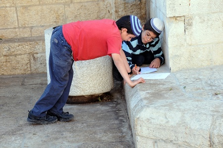 Two Israeli boys are doing their homework in Jerusalem Old City on the 21st of Novwmber, 2010 Editorial