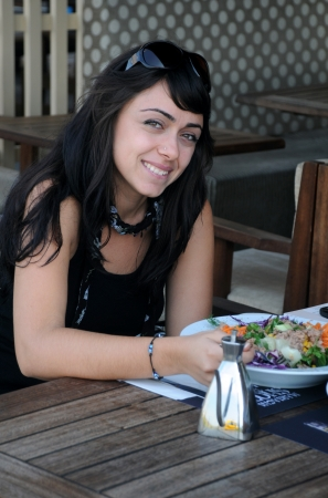 Young beautiful Turkish girl in the restaurant in Izmir (Turkey) on the 1st of October, 2009 Stock Photo - 13337788