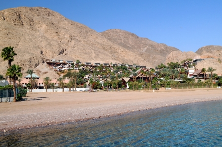 Coast of the Red Sea in Israel with mountains in the background photo