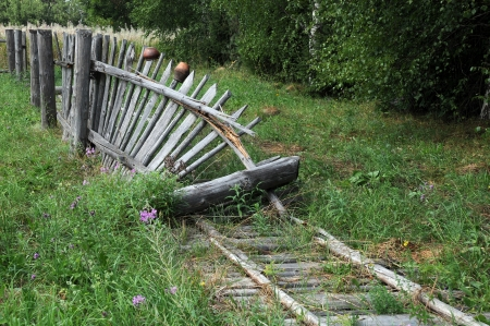 Old broken wooden fence in the Russian village photo