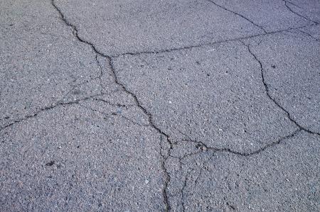 Closeup portion of cracked asphalt road in Kazakhstan photo